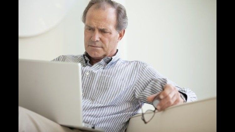 serious-senior-using-laptop-social-security-getty_large