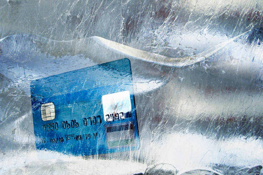 Credit card frozen in ice block